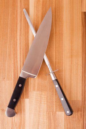 chrome molybdenum: Series. Set of kitchen knifes isolated on wooden background Stock Photo