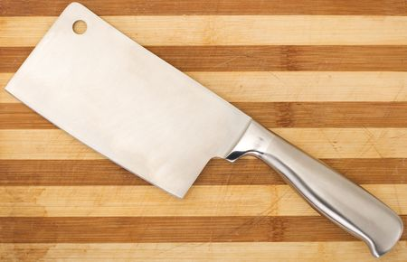 Series. meat cleaver isolated over wooden background photo