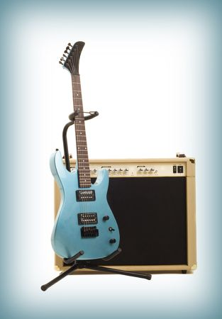 guitar amplifier and electricguitar on gradient background photo