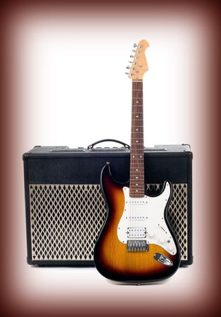 strat: Series. guitar amplifier and electricguitar on gradient background