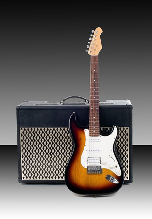 Series. guitar amplifier and electricguitar on gradient background photo