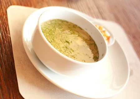 series. A chicken broth with crackers photo