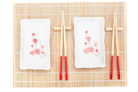 Series. Sushi plates and chopsticks on bamboo mat photo