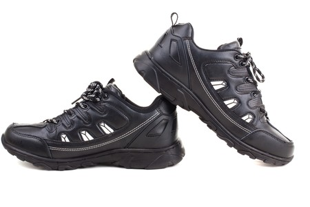 outsole: Series. Black leather shoes on a white background