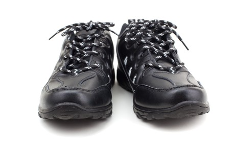 sturdy: Series. Black leather shoes on a white background