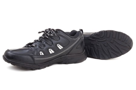 Series. Black leather shoes on a white background photo