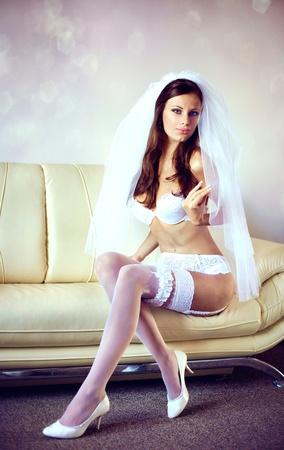 garter: Series. sexy bride in lingerie Stock Photo