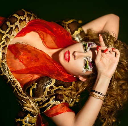captivate: Series. Young beautiful woman whith snake