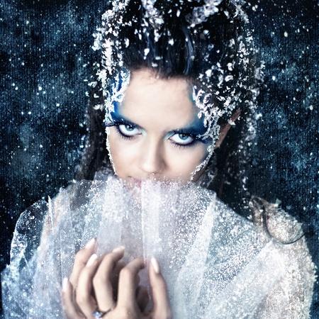 glamur: Series. Beautiful brunette in a dress of Snow Queen