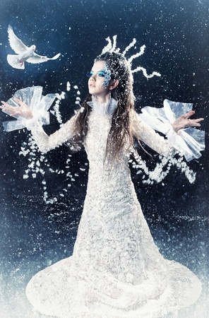 Series. Beautiful brunette in a dress of Snow Queen photo