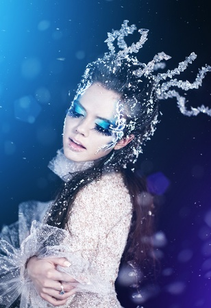snow woman: Series. Beautiful brunette in a dress of Snow Queen