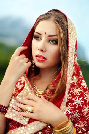 Series. young beautiful brunette in the indian national dress photo