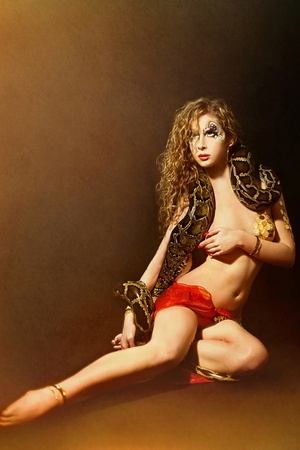 Series. Young beautiful woman whith snake photo
