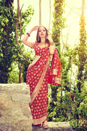 bollywood woman: Series. young beautiful brunette in the indian national dress