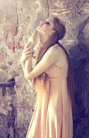 Series. young blond woman posing on wall background photo