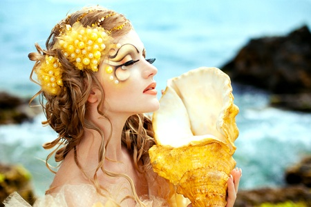 Series. Young beautiful girl in the image of a mermaid photo