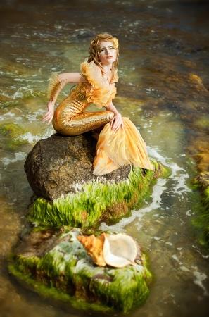 Serie. Niña hermosa en la imagen de una sirena Foto de archivo