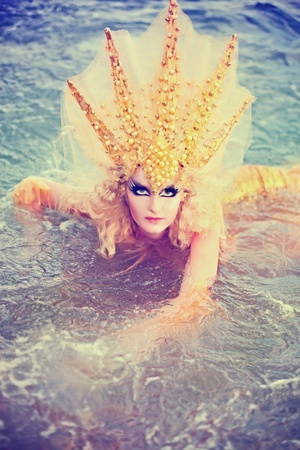 model fish: Series. Young beautiful girl in the image of a mermaid