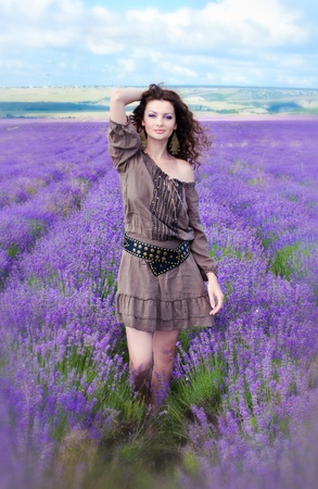 Series. Young beautiful girl in the brown dress in lavender field photo