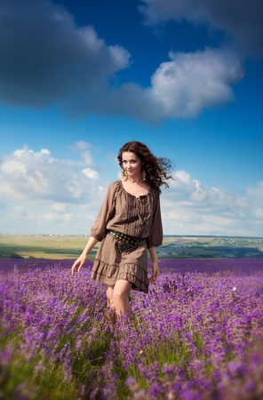 Series. Young beautiful girl in the brown dress in lavender field Stock Photo - 10397045