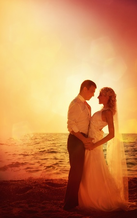 A series. A young and beautiful newly-married couple has gone mad of pleasure and has jumped in the sea photo