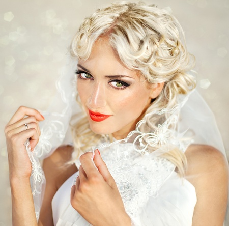series. A portrait of the young beautiful blonde with brightly red lips photo