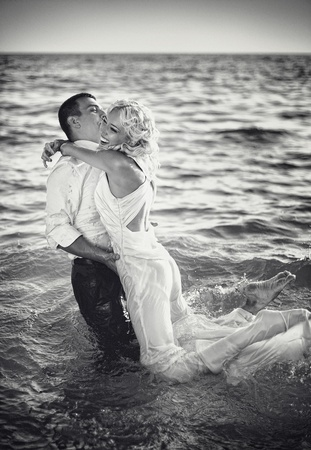 wedding beach: A series. A young and beautiful newly-married couple has gone mad of pleasure and has jumped in the sea