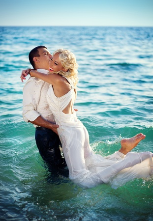 A series. A young and beautiful newly-married couple has gone mad of pleasure and has jumped in the sea