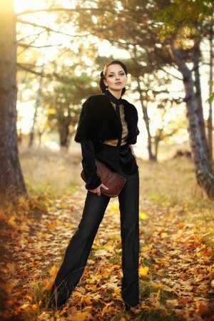 series. A portrait of the young business woman  in autumn park photo