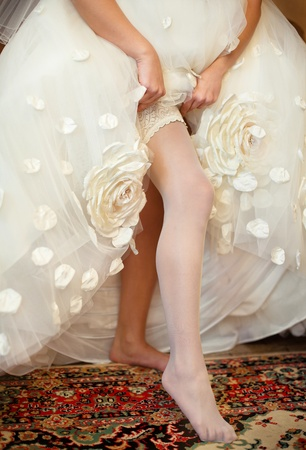 Series. Beautiful leg of the young bride Stock Photo - 11745793