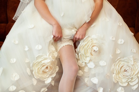 Series. Beautiful leg of the young bride Stock Photo - 11745790