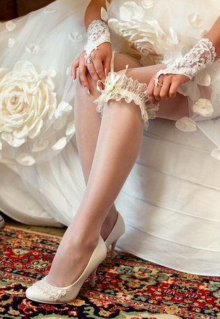 Series. Beautiful leg of the young bride Stock Photo - 11745800
