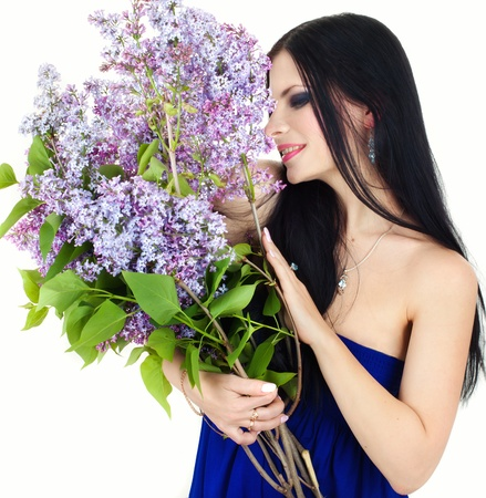Beautiful, smiling women with lilac flowers isolated on white background photo