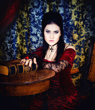 Series  A portrait of the girl in Gothic style with the book in hands photo