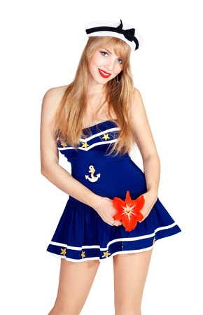 Series. Beautiful sexy woman wearing sailor striped dress posing in studio photo