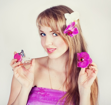 Series. Beautiful girl with pink flowers photo