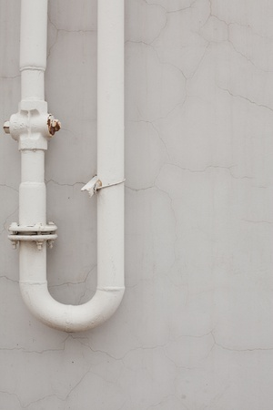 Series. Old rusty pipes against a wall photo