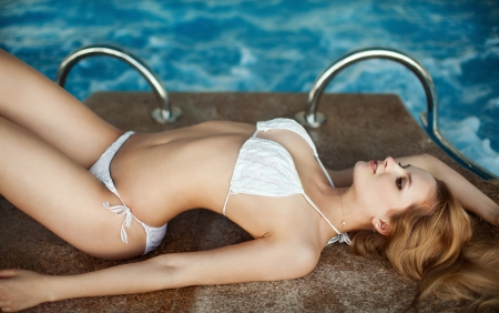 blue bikini: Beautiful young woman at a pool Stock Photo