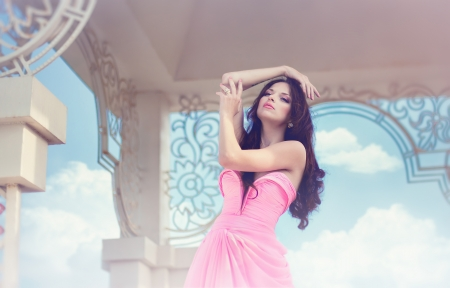 The beautiful harmonous girl in a long pink dress  Stock Photo - 13878004