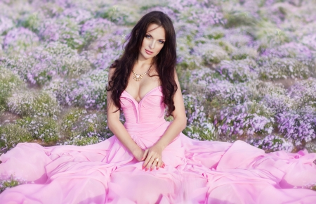 The beautiful harmonous girl in a long pink dress  photo