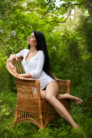desires: Stunning brunette beauty sitting on a chair