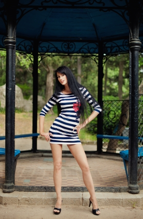The image beautiful high the brunette in park photo
