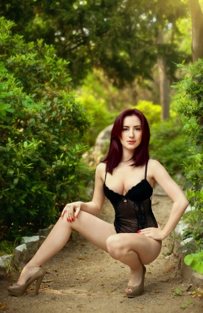outdoor glamour: The image beautiful high the brunette in park