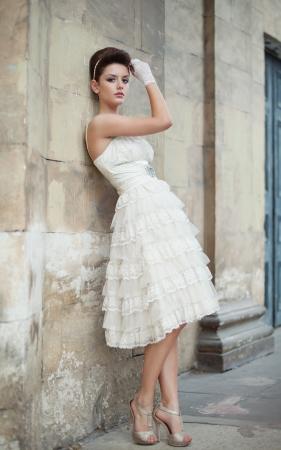 Very beautiful brunette in a wedding dress. Rero style