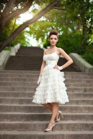 frock: Very beautiful brunette in a wedding dress. Rero style