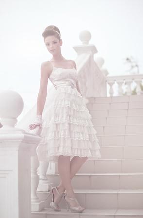 Very beautiful brunette in a wedding dress. Rero style Stock Photo - 14347106