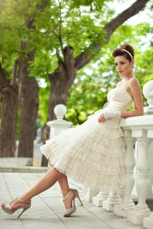 Very beautiful brunette in a wedding dress. Rero style photo