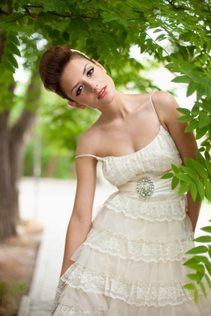 Very beautiful brunette in a wedding dress. Rero style photo
