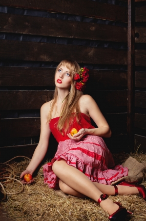 woman in a red dress with an apple in hands on a mow Stock Photo - 14636692
