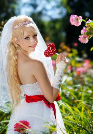 Very beautiful blonde in a wedding dress. photo
